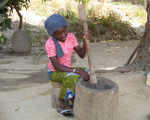 Cecile pounding baobab seeds